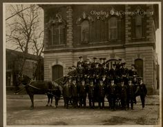 ID#0137 Date: Unknown. This image shows the entire fire fighting crew in uniform with a horse-drawn fire wagon in front of Town Hall. Participant: Chief Dennis. Additional Sources: Oberlin Heritage Center: City Directories. The Rotary Club of Oberlin, Pictorial Memories of Oberlin, 1976 and 1989.