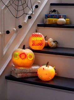 To make these '80s-inspired jack-o'-lanterns, start with hollowed-out pumpkins and Lite-Brite pegs. Trace out your design with washable marker, then poke the outline with the piercing tool that comes with a pumpkin-carving set (a thin screwdriver also works). Wipe off the marker residue with a damp paper towel, push pegs into the holes, and place a few battery-operated candles inside to make it glow.
