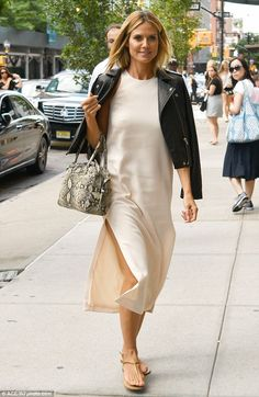 Effortless chic! Heidi looked stylish in a simple midi dress with gold sandals earlier in ...