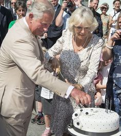 The couple used a ceremonial sword to slice the cake before the crowd erupted into an impromptu rendition of Happy Birthday