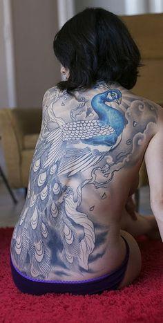 *Beautifully* done back piece #body_art #tattoo #peacock