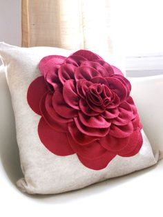 Eco friendly oatmeal and brick red felt peony cupcake fluff flower pillow cover. $35.00, via Etsy.