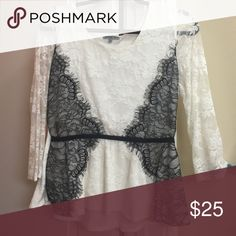 Black and white lace peplum top long sleeve Black and white peplum shirt long sleeve. Lace. Beautiful sheer sleeves size L worn once. Has black waistband to accentuate your tint waist! Charlotte Russe Tops Blouses
