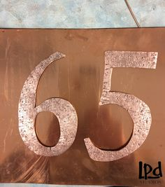 LPDstudios Blog: Custom Corner - Copper Metal Address Plaque. Next, I needed to create a backing that the numbers could be affixed to. I chose a 1/16th inch thick, 18 gauge copper metal sheet . Here you can see the raw copper metal prior to hand distressing.