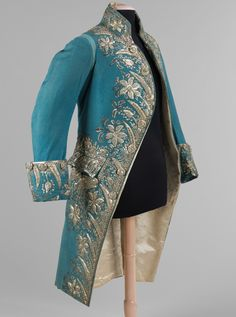 Court Coat 1775-89 The elegance and grandeur of 1770s and 80s court dress is displayed in this court coat. The magnificent array and abundance of silver decorations used to adorn the jacket would have sparkled in flickering candlelight and indicated the status of the wearer who could afford such an expensive garment.