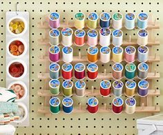 Magnetic spice tins and a thread organizer from a fabric store keep buttons and spools organized and handy.