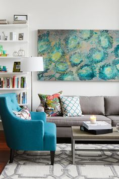 Starting with a white box, we give Meredith's living room a colorful, rental-friendly redesign.