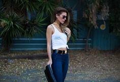 (Sunglasses - Gucci, Tank - Paige, Belt - Anthony Vaccarello x Versus,  Denim - Paige, Clutch - Givenchy)