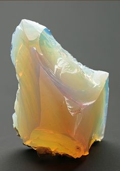 A fine example of Opal from the Cervenica area in Slovakia. The specimen is gemmy to translucent with a pleasing display of orange (fire opal) and misty blue-white.