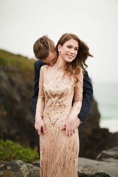 Elegant champagne and gold sequin wedding dress with low back and long sleeves