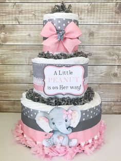 This popular Elephant design is one of our top sellers! Decorated in a pink and gray color scheme and designed using brand name diapers and high end materials this Baby Shower Centerpiece will be the talk of the party! This Themed Diaper Cake would make the perfect centerpiece for the #babyshowerniña