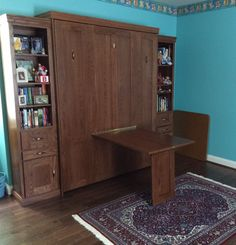 Our customer from Oak Ridge, Tennessee chose the BedderWay Vertical Queen Table Face Murphy bed in Oak stained Country Pine with antique brass traditional pull handles and two side cabinets for additional storage.