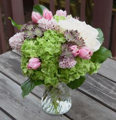 Flower arrangement with hydrangeas, roses, hyacinths, tulips and astrantia.