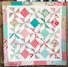 Papillon fabric with pinwheels & squares.