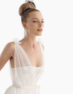 I love the sheerness of the straps and bodice! It instantly gives the wedding dress a Grecian vibe while keeping it delicate.