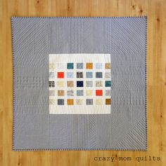 crazy mom quilts: doe quilt.  Used a pillow top for the center, added a solid to make it quilt size
