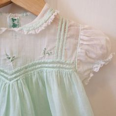 Vintage 1950s mint green party dress for baby girl.  D E T A I L S Intricate fagoting detail & leaf embroidery on front & back bodice Petite