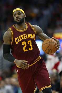 LeBron James #23 of the Cleveland Cavaliers drives the ball up the court against the New Orleans Pelicans at Smoothie King Center on December 12, 2014 in New Orleans, Louisiana.