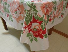 """Vintage Table Cloth 1940s or 50s Heavy  cotton blend white, pattern is georgeous huge red and peach flowers with green leaves 50"""" by 64"""". $26.50, via Etsy."""