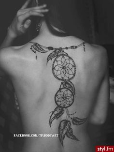 I absolutely love this.. dreamcatcher tattoo down back