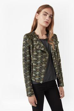 "<ul> <li> Jacquard biker jacket in camouflage and floral pattern</li> <li> Off-centre front zip fastening</li> <li> Long sleeves</li> <li> Contrast solid black panelling at sides and lower-side sleeves</li> <li> Slim fit - gently cropped length</li> <li> UK size 10 length is 51cm</li> </ul>  <strong>Our model is 5ft 9"" and is wearing a UK size 10. </strong&..."