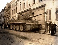 A Tiger I. abandoned in a French town after the invasion in Normandy.