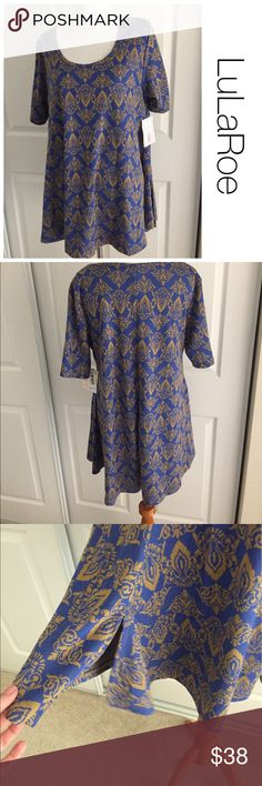 NWT LuLaRoe Perfect T size M NEW WITH TAG♦️Materials- rayon/poly blend blend♦️Laying flat armpit to armpit: approximately 20 inches  ♦️Laying flat from the back of the neck to the bottom of the front hem is approximately 28 inches LuLaRoe Tops Tunics