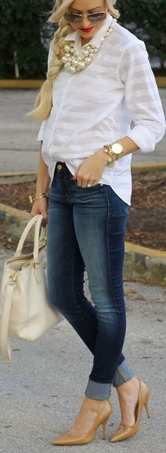 Love this white blouse with chunky accessories.