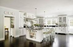 white kitchen dark floors