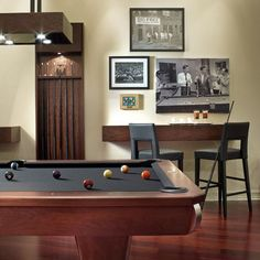 Like the bar stool idea and the pictures of the pool tables.  Also like the mount to hold the pool sticks.