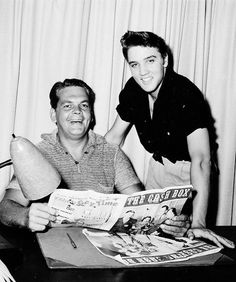 Elvis Presley || Bob Neal and Elvis looking over Cash Box Magazine - ca. Aug. 1955