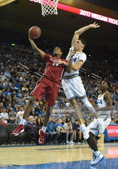 8dfd5cb5f28 Lonzo Ball (G) attempts to block a shot by Stanford (14) Marcus