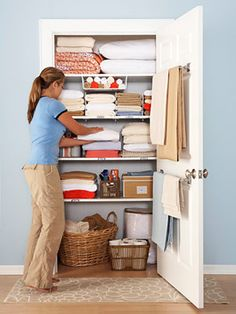 Towel bars on door, baskets, shelf organizers for washcloths and hand towels.