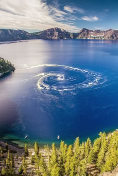 Giant Swirl At Crater Lake National Park, Oregon. Description: Giant swirl phenomenon at crater lake national park, Oregon. a giant swirl of pollen had formed on the surface of crater lake. Crater Lake National Park, National Parks, Places To Travel, Places To See, Travel Destinations, Places Around The World, Around The Worlds, Beautiful World, Beautiful Places