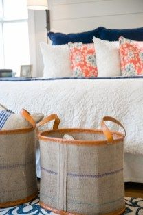 Navy, coral and cream master bedroom with shiplap details
