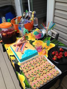 #Luau theme bachelorette party complete with sangria, flip flop nutter butters, beach cake