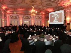 up lighting in red at Greysolon Ballroom. Duluth Event Lighting. Duluth, MN. Wedding lighting, bridal lighting, reception lighting.