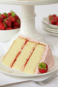 Strawberry Layer Cake - with layers of tender, moist yellow cake sandwiched between a double dose of strawberries - fresh strawberry buttercream and strawberry jam, this cake is the kind of confection that dreams are made of!