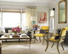 Kelie Rosso in House Beautiful ...neutral shell, yellow chairs, blue and white, pink poppin' peonies