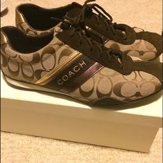 EUC Coach Sneakers Authentic Brown Coach Sneakers in a size 8.5. They have been worn but overall are still in great condition. I have not attempted to clean them but cleaning instructions are included in the box and will probably make them look brand new!! I included as many pictures as possible. If you would like more please ask! Coach Shoes Sneakers