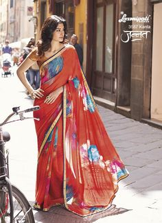 Complete the Rich Look with our Charming Scarlet Red Coloured Embellished printed Georgette Saree which will add to your beauty and will set you unique. It comes with Fancy Fabric Mustarcd coloured Blouse. www.laxmipati.com