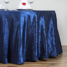 """Navy Pintuck Tablecloths 132"""" Round - Pintuck is actually a fold of fabric that is stitched intricately to hold it in a place, very much like a pleat. These lovely pleats impart a decorative effect to the fabric by fashioning a visual line at a chosen point. They effortlessly bridge vintage and contemporary styles to create a majestic new classic look. If you do not want your celebration to blend in with other weddings, birthdays, and anniversaries, try our premium quality pintuck…"""