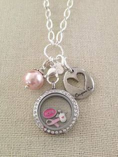 Breast Cancer Awareness for October. Contact me to learn how to get a free pink ribbon charm with your purchase of $50 or more! http://facebook.com/dawnrobertsonorigamiowl