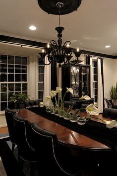 Love the white walls, black trim. Looks like my house :) black chandelier black dining room chairs! - Home Decor Max Dining Room Design, Interior Design Kitchen, Dining Area, Interior Decorating, Dinning Table, Decorating Ideas, Black And White Dining Room, Beautiful Dining Rooms, Traditional Interior