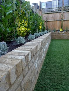 Yellow brick raised bed walls artificial fake easy grass lawn mixed planting herne hill dulwich london - All For Garden Backyard Retaining Walls, Backyard Landscaping, Landscaping Ideas, Cheap Raised Garden Beds, Raised Beds, Raised Flower Beds, Building Raised Garden Beds, Brick Flower Bed, Brick Planter