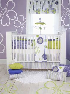 Luscious lavender and lime for baby. Love the whitewashed wood floor look with the lime flowers!