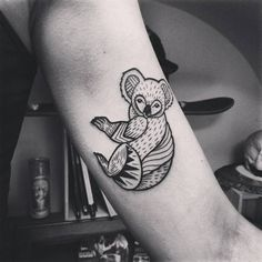 Koala tattoo on the left inner arm.