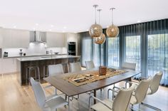Contemporary kitchen and dining room by Johnson & Associates Interior Design