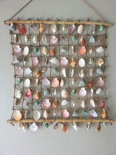 Make a wall hanging with shells from the beach. Get free lingerie at http://www.kinky-lingerie.co.uk