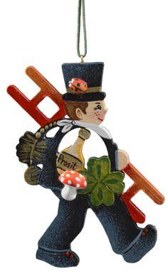 http://www.bestofchristmas.com/Baumbehang/Baumbehang-aus-der-Rothenburger-Weihnachtswerkstatt/Gluecksbringer/Gluecks-Bringer-Schornsteinfeger.html....children run behind the chimney sweepers to touch them for good luck.